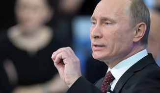 Russian Prime Minister Vladimir Putin appears on a national call-in TV show in Moscow on Thursday, Dec. 15, 2011. (AP Photo/RIA Novosti, Alexei Nikolsky, Pool)