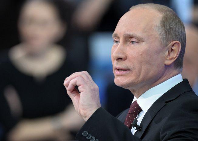 Russian Prime Minister Vladimir Putin appears on a national call-in TV show in Moscow on Thursday, Dec. 15, 2011. (AP Photo/RIA Novosti, Alexei Nikolsky, Pool)