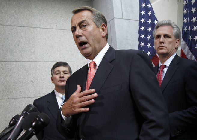 House Speaker John Boehner (center), Ohio Republican, flanked by Rep. Jeb Hensarling (left), Texas Republican, and House Majority Whip Kevin McCarthy, California Republican, briefs reporters Dec. 16, 2011, on Capitol Hill after lawmakers from both political parties came together on an 11th-hour deal to keep the government from shutting down. (Associated Press)