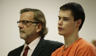 "Colton Harris-Moore, right, also known as the ""Barefoot Bandit,"" stands with his attorney, John Henry Browne, in Island County Superior Court, Friday, Dec. 16, 2011, in Coupeville, Wash. Harris-Moore pleaded guilty Friday to burglary and theft charges in the Barefoot Bandit case. The 20-year-old softly answered affirmatively when the judge asked if he understood his rights. He said guilty when the judge asked how he wanted to plead. (AP Photo/Ted S. Warren)"
