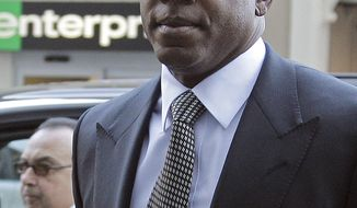 Former baseball player Barry Bonds arrives Dec. 16, 2011, at federal court in San Francisco for sentencing after being convicted in April of obstructing a government investigation into steroid use among athletes. (Associated Press)