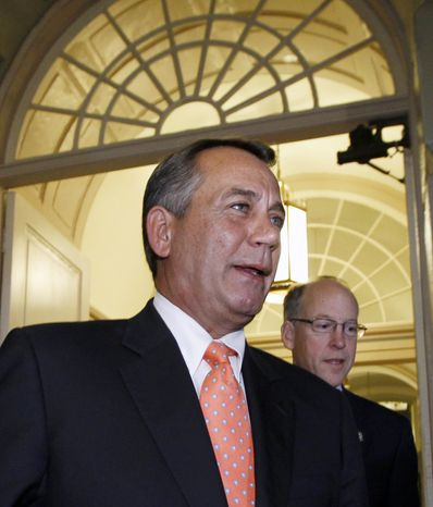 """House Speaker John Boehner, Ohio Republican, followed by Rep. Greg Walden, Oregon Republican, strides into a GOP strategy session on Capitol Hill singing """"Zip-a-Dee-Doo-Dah"""" on Dec. 16, 2011, the morning after lawmakers from both political parties came together on an 11th-hour deal to keep the government from shutting down. (Associated Press)"""