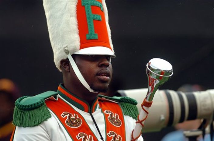 Robert Champion, a drum major in Florida A&M University's Marching 100 band, performs during halftime of a football game in Orlando, Fla., on Saturday, Nov. 19, 2011. (AP Photo/The Tampa Tribune, Joseph Brown III)