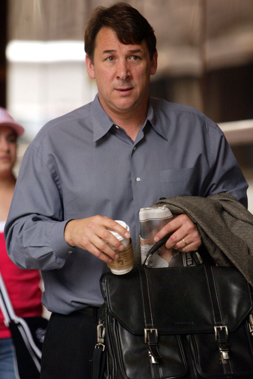 FILE - In this April 20, 2005 file photo, New York Islanders general manager Mike Milbury arrives at a hotel in New York for a meeting between league owners and general managers. Milbury, also a former Boston Bruins player and coach, has been charged with assaulting and threatening a 12-year-old Pee Wee hockey player in Brookline, Mass. (AP Photo/Mary Altaffer, File)
