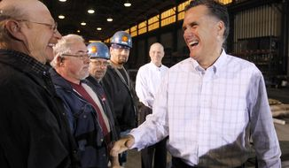 Former Massachusetts Gov. Mitt Romney arrives for a rally at Missouri Valley Steel in Sioux City, Iowa, on Friday, Dec. 16, 2011, in his bid for the Republican presidential nomination. (AP Photo)
