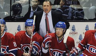 ** FILE ** In this Dec. 8, 2011, photo, Montreal Canadiens head coach Jacques Martin reacts during the third period of an NHL hockey game against the Vancouver Canucks, in Montreal. Martin has been fired as coach of the last-place Montreal Canadiens. (AP Photo/The Canadian Press, Graham Hughes)