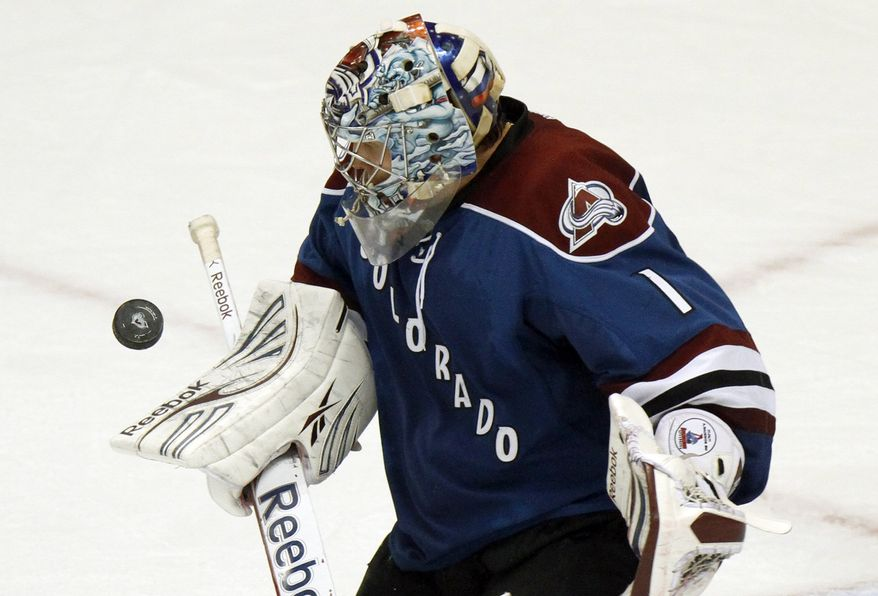Colorado Avalanche goalie Semyon Varlamov makes a save late in the third period against the San Jose Sharks on Tuesday, Dec. 13, 2011 in Denver. The Avalanche won 4-3. (AP Photo/Barry Gutierrez)