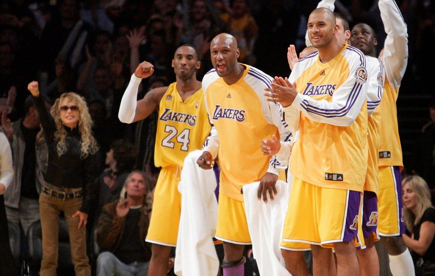 "Members of the Los Angeles Lakers on the bench celebrate a play as actress Dyan Cannon (left) celebrates as well. The Lakers have had a higher profile, and better record, than ""the other"" pro basketball team in Los Angeles, the Clippers. The latter's acquisition of star player Chris Paul could change things. (Associated Press)"