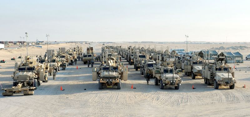 **FILE** U.S. Army soldiers from the 1st Cavalry Division, the last American unit to leave Iraq, arrive at Camp Virginia in Kuwait. (Associated Press)