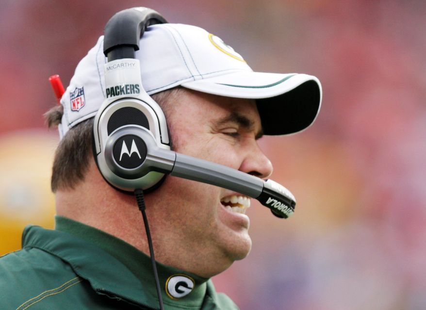 Green Bay Packers coach Mike McCarthy talks with coaches in the booth during the first half of an NFL football game against the Kansas City Chiefs at Arrowhead Stadium in Kansas City, Mo., Sunday, Dec. 18, 2011. (AP Photo/Ed Zurga)