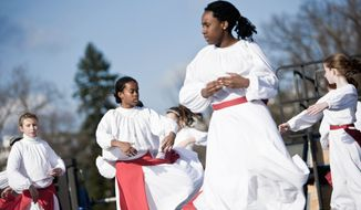 Members of the Children of the Light Dancers, from Fairfax, including Sarah Runyon, Naomi Nero, Zoe Walker and Nathalie Vadnais (top, from left) perform Sunday for an audience gathered near the National Christmas Tree on the Ellipse. (T.J. Kirkpatrick/The Washington Times)