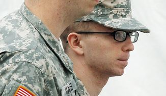 Army Pfc. Bradley Manning (right) is escorted to a military hearing at Fort Meade,, Md., on Sunday that will determine if he should face court-martial for his alleged role in the WikiLeaks classified leaks case. The hearing entered its third day Sunday. (Associated Press)