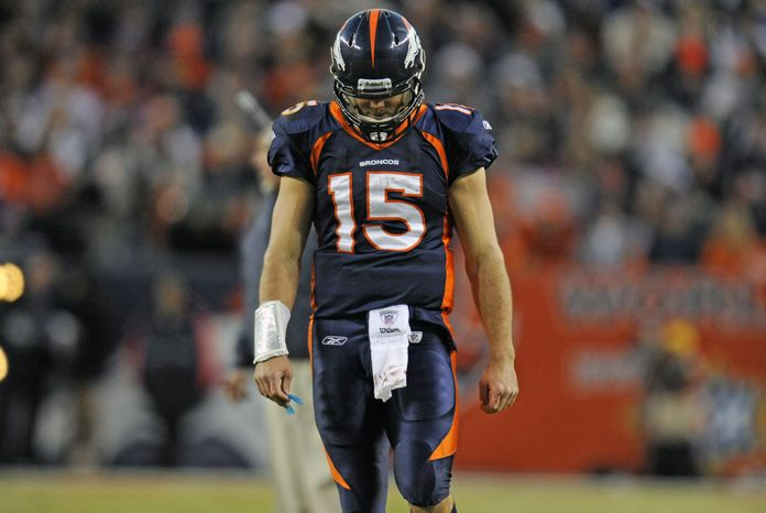 Denver Broncos quarterback Tim Tebow during the fourth quarter of an NFL football game Sunday Dec. 18, 2011 at Sports Authority Field at Mile High. (AP Photo/The Denver Post, Tim Rasmussen)