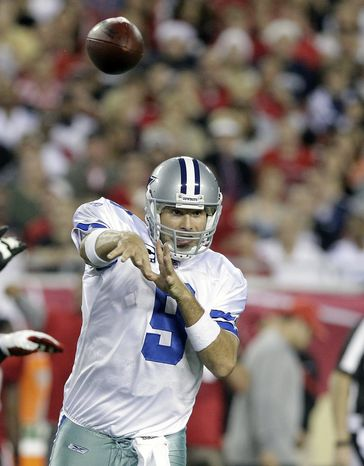 Dallas Cowboys quarterback Tony Romo threw for 249 yards and three touchdowns, while rushing for another, in his team's 31-15 win against the Tampa Bay Buccaneers on Saturday night. (AP Photo/John Raoux)