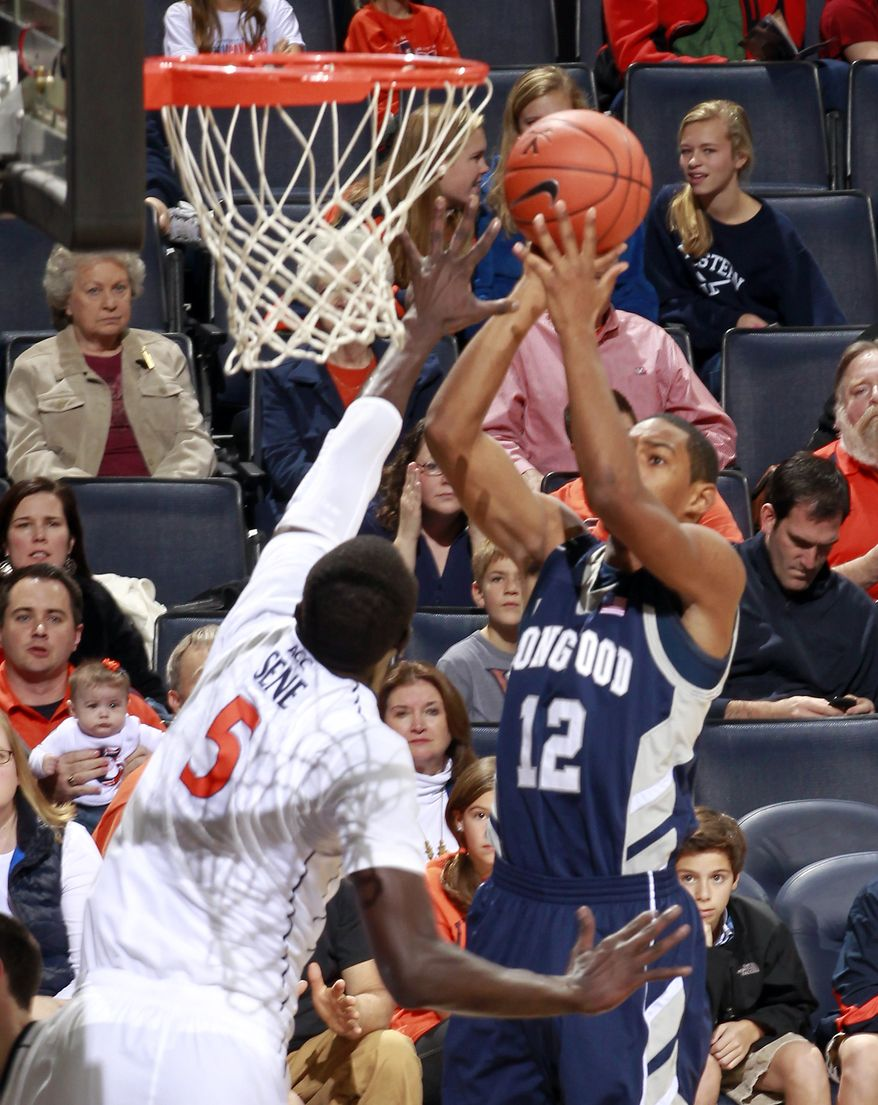 Longwood guard Tristan Carey (12) shoots in front of Virginia center Assane Sene (5) during the first half, Saturday, Dec. 3, 2011, in Charlottesville, Va. (AP Photo/Andrew Shurtleff)