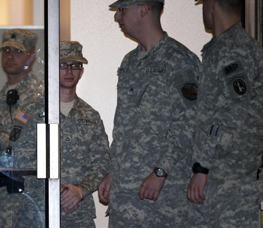 Army Pfc. Bradley Manning (second from left) is escorted from a courthouse in handcuffs on Saturday, Dec. 17, 2011, at Fort Meade, Md. (AP Photo/Cliff Owen)