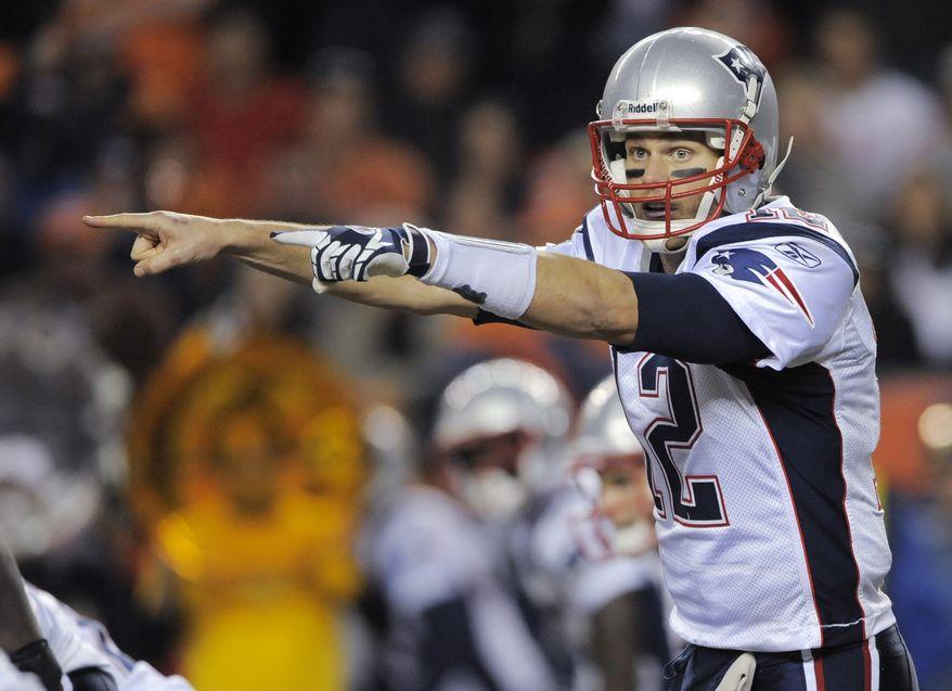 New England Patriots quarterback Tom Brady makes a call against the Denver Broncos on Sunday, Dec. 18, 2011, in Denver. (AP Photo/Jack Dempsey)