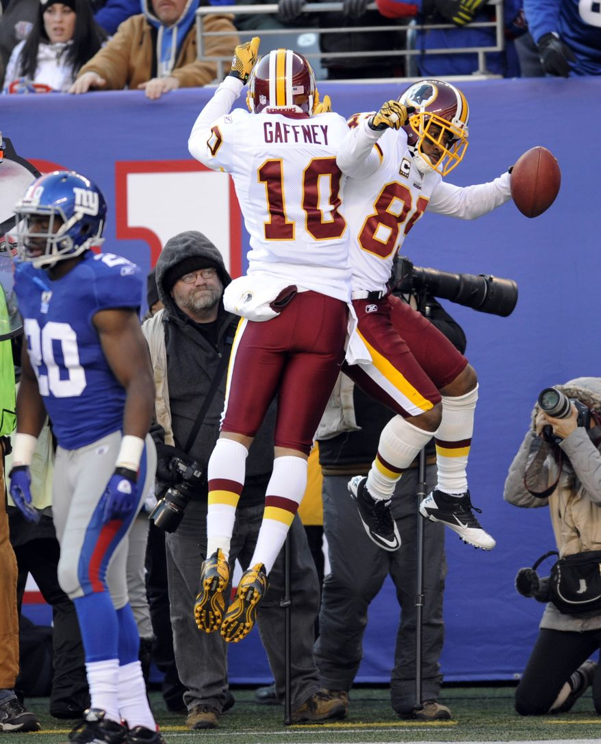 Washington Redskins' Santana Moss, right, celebrates his touchdown with teammate Jabar Gaffney during the second quarter of an NFL football game against the New York Giants, Sunday, Dec. 18, 2011, in East Rutherford, N.J. (AP Photo/Bill Kostroun)