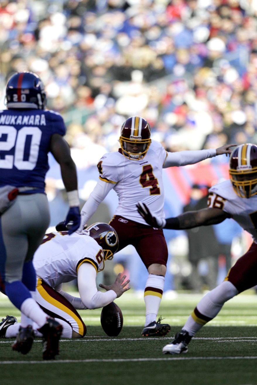 Washington Redskins kicker Graham Gano (4) kicks a field goal during the first quarter. (AP Photo/Kathy Willens)