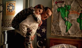 "In this scene from Warner Bros. Pictures' ""Extremely Loud & Incredibly Close,"" Oskar Schell (Thomas Horn) bonds with his father, Thomas (Tom Hanks). (Associated Press)"