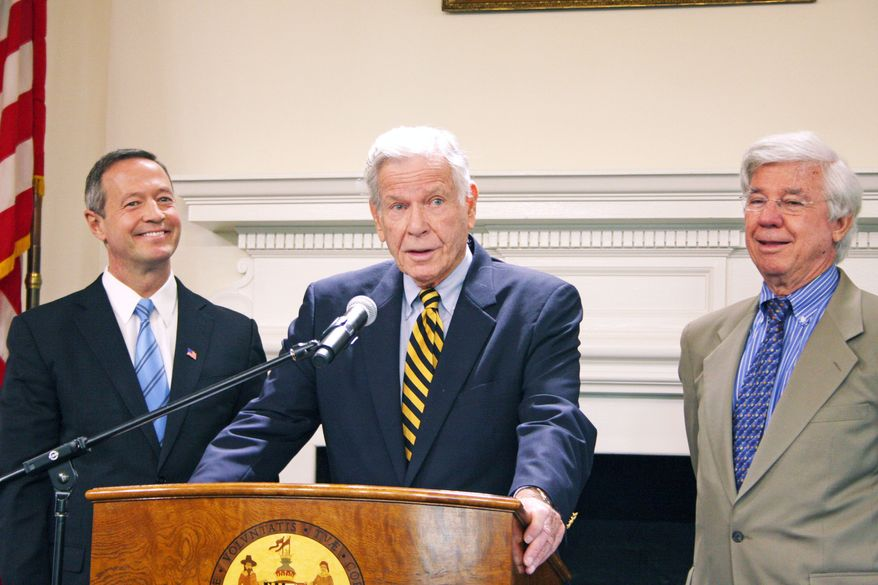 Former Maryland Gov. Harry Hughes (center) joins Gov. Martin O'Malley (left) and former Gov. Parris N. Glendening on Monday in Annapolis to mark the submission of PlanMaryland, a long-range plan for sustainable growth, to Mr. O'Malley after four years of work on the plan by state officials. (Associated Press)