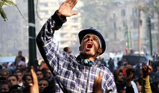 An Egyptian man chants slogans denouncing military rule in Cairo's Tahrir Square. At least three people were killed during a military sweep early Monday, pushing the death toll from four days of street clashes to at least 14. (Associated Press)