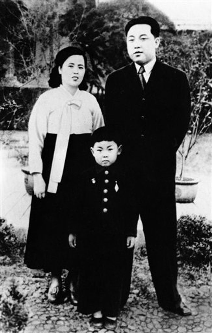 In this undated photo from North Korea's official Korean Central News Agency, Kim Jong-iI (center) is pictured with his parents, Kim Jong-suk (left) and Kim Il-sung. (AP Photo/Korean Central News Agency via Korea News Service)