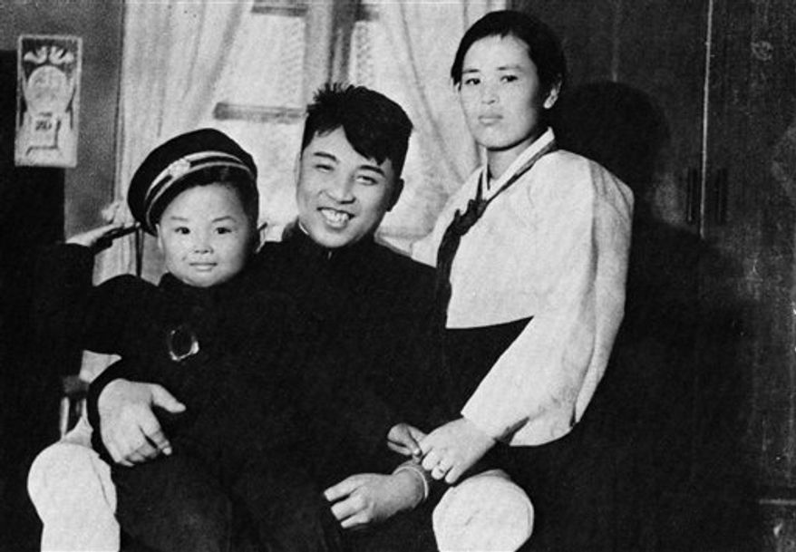 In this undated photo from North Korea's official Korean Central News Agency, a young Kim Jong-il (left) is pictured with his parents, Kim Jong-suk (right) and Kim Il-sung. (AP Photo/Korean Central News Agency via Korea News Service)