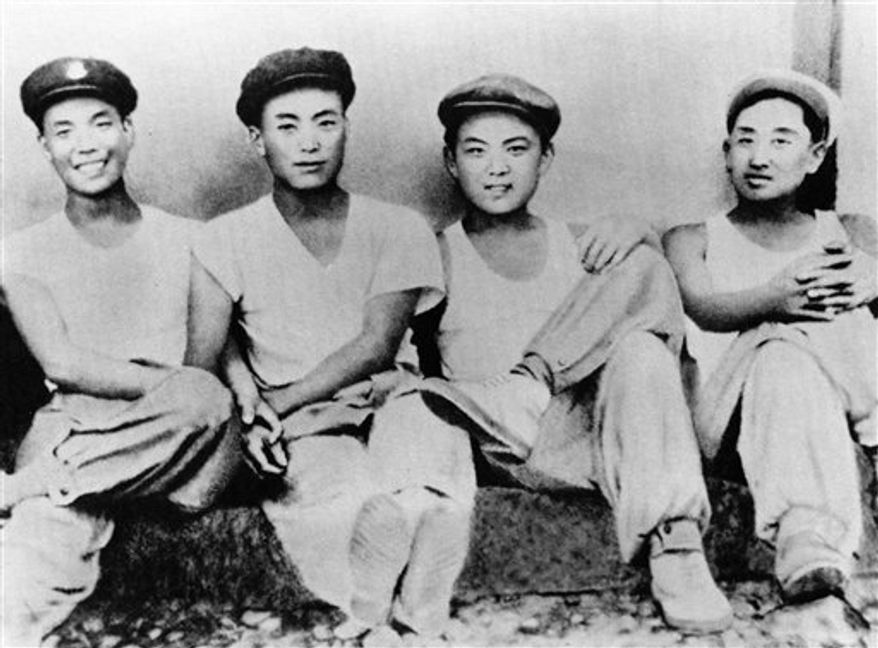 In this undated photo from North Korea's official Korean Central News Agency, a young Kim Jong-il (second from right) appears in a souvenir picture with his friends. (Korean Central News Agency/Korea News Service via AP Images)