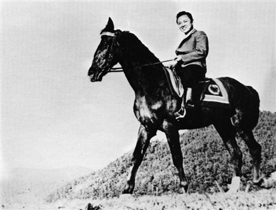 In this undated photo from North Korea's official Korean Central News Agency, a young Kim Jong-il rides a horse. (Korean Central News Agency/Korea News Service via AP Images)