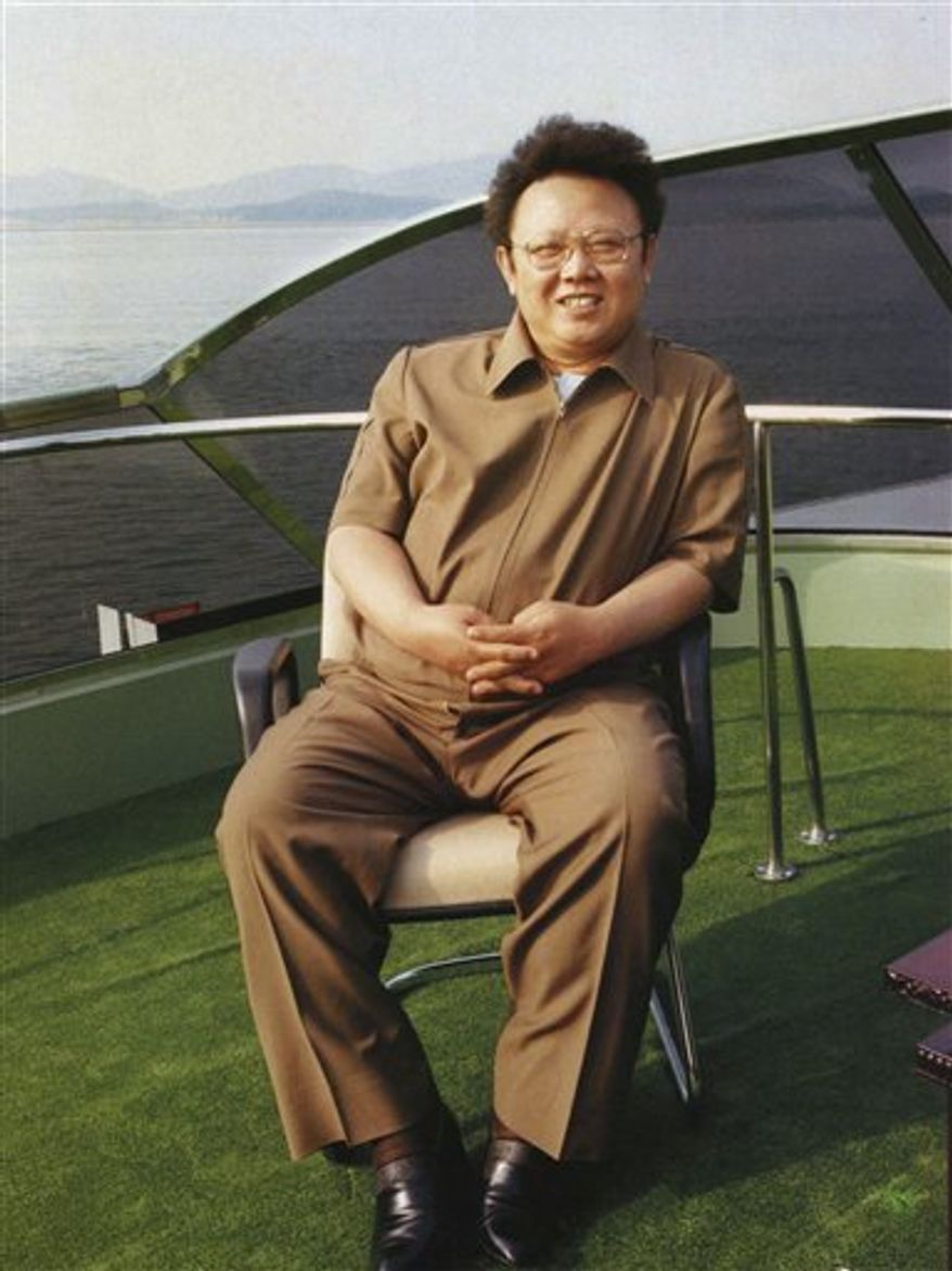 In this undated photo from North Korea's official Korean Central News Agency, the country's leader, Kim Jong-il, is shown on a boat in North Korea. (Korean Central News Agency/Korea News Service via AP Images)