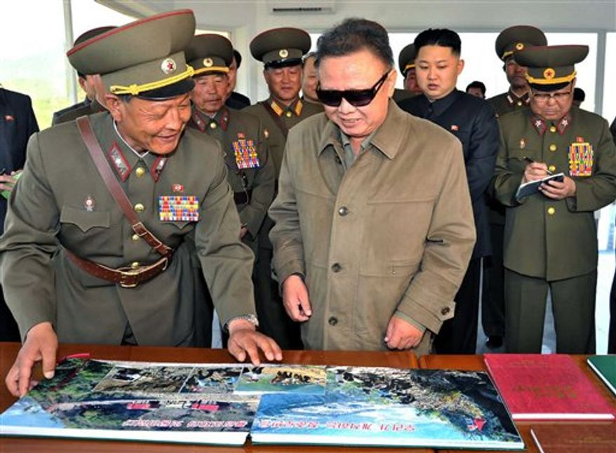 In this undated photo released by North Korea's official Korean Central News Agency (KCNA) on Saturday, May 28, 2011, North Korean leader Kim Jong-il (center right), accompanied by his son Kim Jong-un (third from right), inspect the construction site of the Huichon Power Station in Jokang Do, North Korea.  (AP Photo/Korean Central News Agency via Korea News Service)