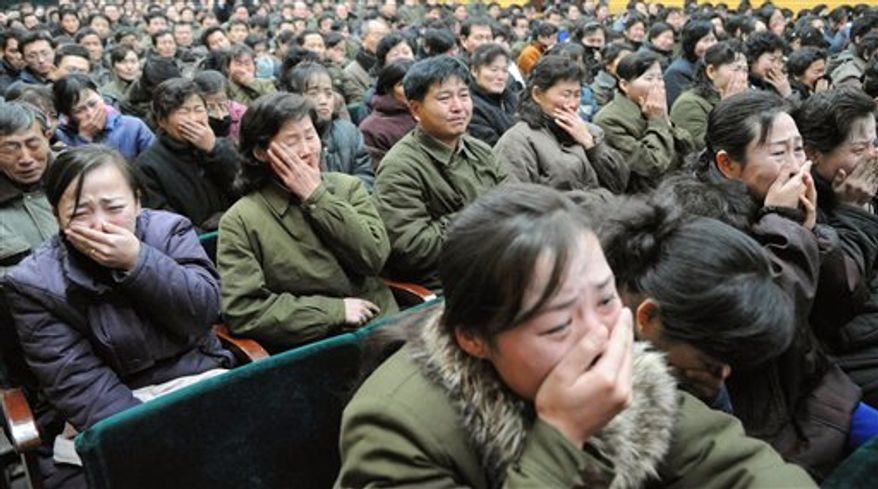 North Koreans in the capital, Pyongyang, cry after learning on Monday, Dec. 19, 2011, of the death of their leader, Kim Jong-il. (AP Photo/Kyodo News)