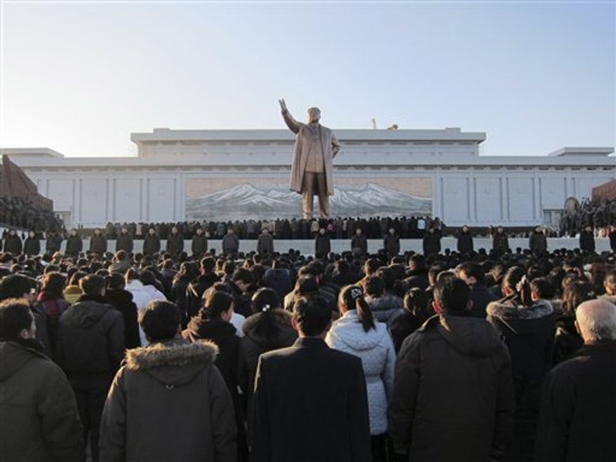 Hundreds of North Koreans gather in front of a giant statue of former leader Kim Il-Sung in Pyongyang, North Korea, on Monday, Dec. 19, 2011, to mourn the death of Kim Jong-il. (AP Photo/APTN)