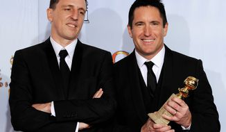 "Composers Trent Reznor (right) and Atticus Ross began scoring ""The Girl With the Dragon Tattoo"" before production of the film had begun. (Associated Press)"