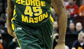 George Mason senior guard Andre Cornelius was suspended 10 games for pleading guilty to misdemeanor credit card fraud in November. (Associated Press)