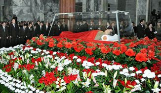Kyodo News via Associated Press The body of longtime North Korean leader Kim Jong-il lies in state Tuesday in a memorial palace in Pyongyang, North Korea. The Stalinist Northeast Asian nation is in an 11-day period of official mourning.