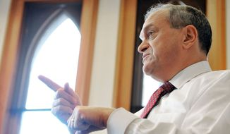 In this Friday, Dec. 16, 2011 photo, New Haven Mayor John DeStefano speaks during an interview in his office at City Hall in New Haven, Conn. DeStefano, the 10-term mayor of New Haven, helped illegal immigrants come out of the shadows five years ago with an ID card program. (AP Photo/Jessica Hill)