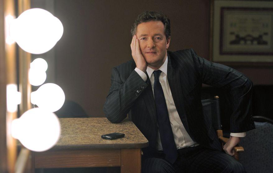 "** FILE ** Piers Morgan, host of CNN's ""Piers Morgan Tonight,"" poses in Pasadena, Calif., on Thursday, Jan. 6, 2011. (AP Photo/Chris Pizzello, File)"