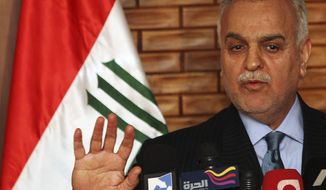 ** FILE ** In this Thursday, Dec. 3, 2009, file photo, Iraq's vice President Tariq al-Hashemi speaks during a news conference in Baghdad, Iraq. (AP Photo/Karim Kadim, File)
