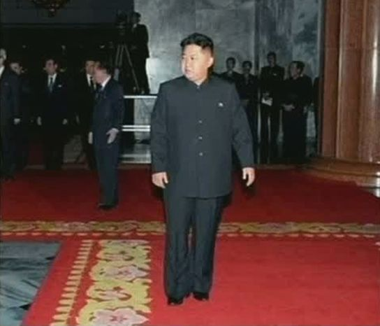 In this image made from KRT television, Kim Jong-un, North Korean leader Kim Jong-il's youngest known son and successor, visits the body of senior Kim with top military and Workers' Party officials in a memorial palace in Pyongyang, North Korea, on Tuesday, Dec. 20, 2011. (AP Photo/KRT)