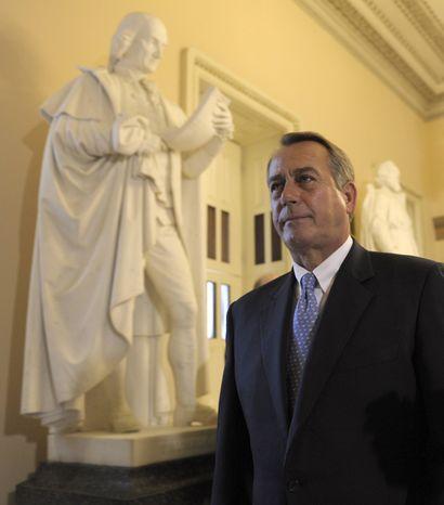 House Speaker John A. Boehner, Ohio Republican, walks Dec. 20, 2011, to the House floor in the Capitol in Washington. (Associated Press)