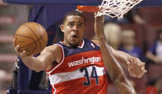 Washington Wizards' JaVale McGee(34) goes for a score against the Philadelphia 76ers in the second half of a preseason NBA game Tuesday, Dec. 20, 2011, in Philadelphia. The 76er's won 101-94. (AP Photo/H. Rumph Jr )