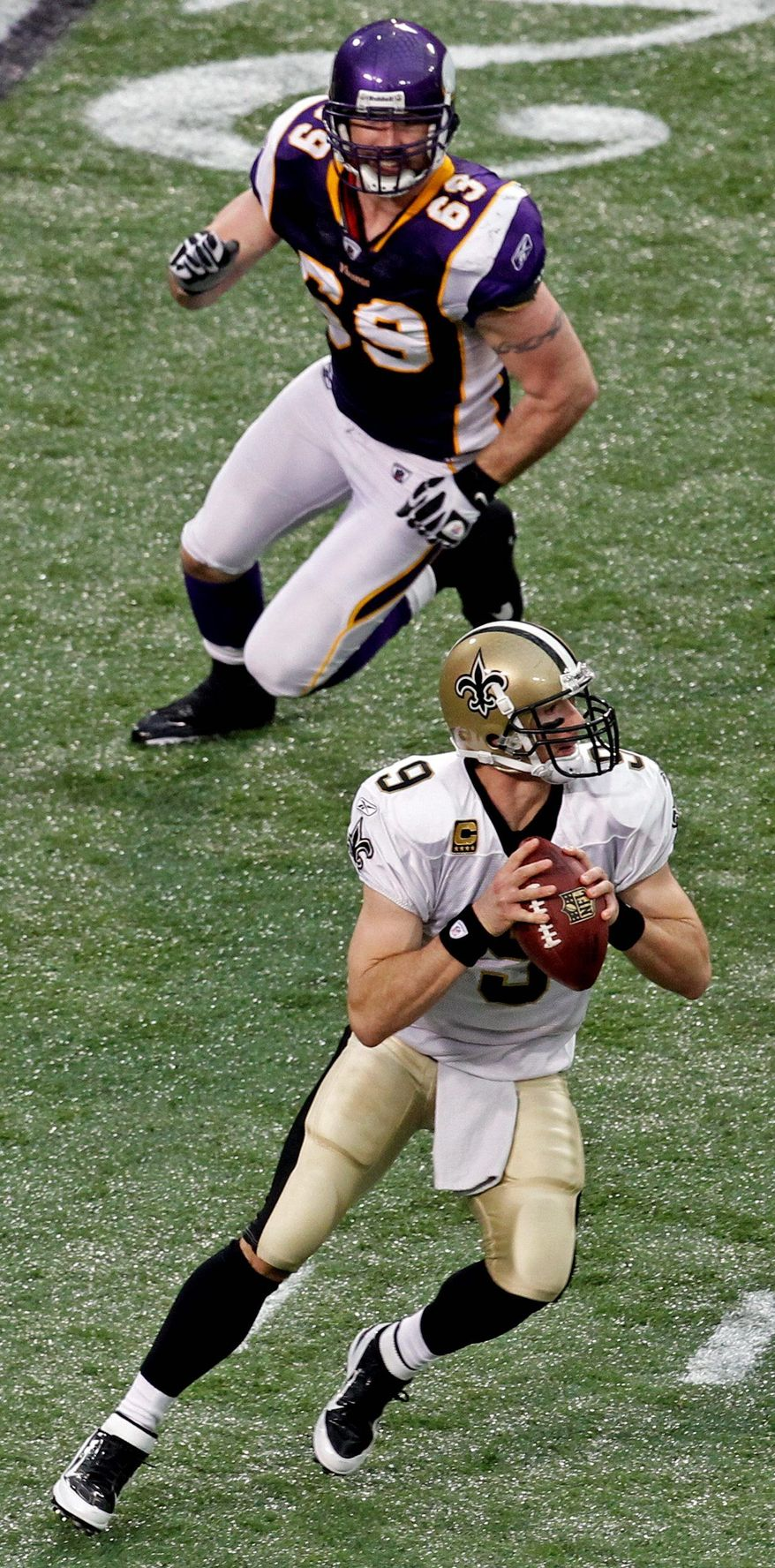 Minnesota defensive end Jared Allen, bearing down on New Orleans' Drew Brees, has 17.5 sacks entering Saturday's game at Washington. (Associated Press)
