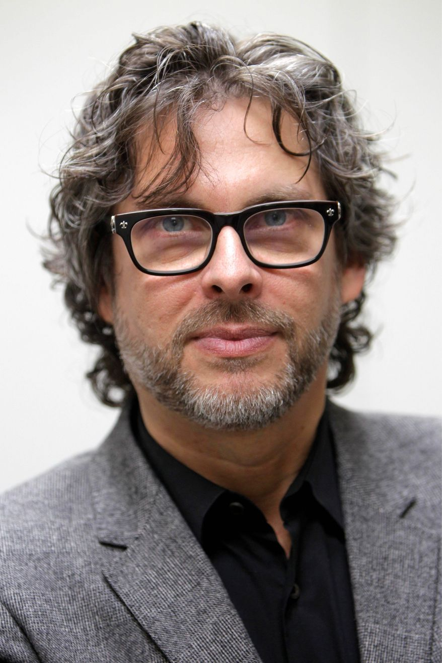 """I didn't want to get left behind in the e-book revolution,"""" author Michael Chabon says about taking the traditional e-book royalty for his recent works though he says it's too low. (Associated Press)"""