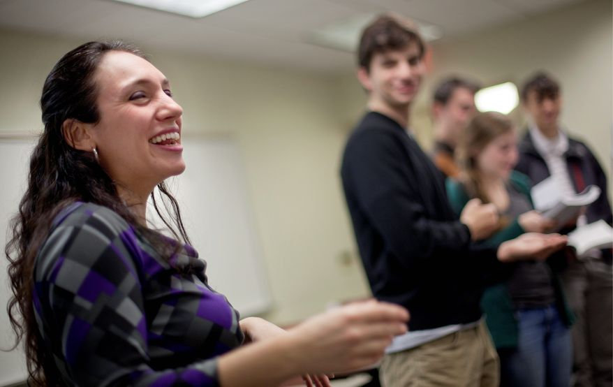 "Miriam Udel leads a song in Yiddish at Emory University in Atlanta. ""The generation that passively knows Yiddish is dying out. There are treasures that need to be preserved because we'll lose access to them if we let Yiddish die,"" she says. (Associated Press)"