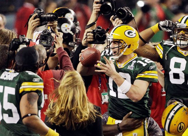 FILE - In this Feb. 6, 2011, file photo, Green Bay Packers quarterback Aaron Rodgers (12) celebrates with teammates after defeating the Pittsburgh Steelers 31-25 in the NFL Super Bowl XLV football game in Arlington, Texas. Rodgers is the 2011 Male Athlete of the Year chosen by members of The Associated Press after his MVP performance in the Green Bay Packers' Super Bowl victory in February and his stellar play during the team's long unbeaten run this season. (AP Photo/Kathy Willens, File)