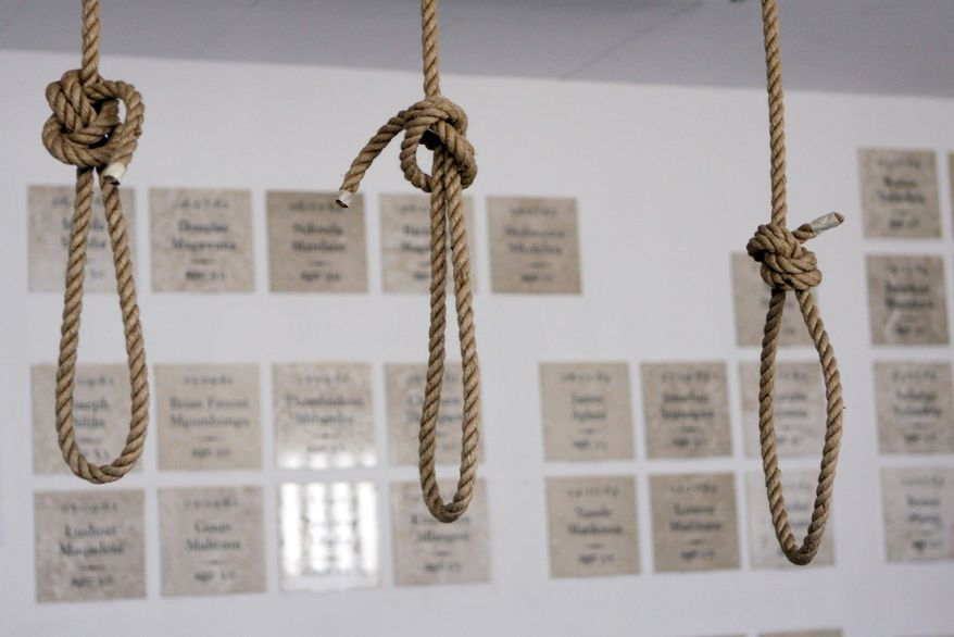Nooses hang in the replica of the gallows at Pretoria Central Prison. In background are plaques to those political prisoners who were executed. A prison employee who said he had been a death row guard helped ensure the new museum's details are correct, down to the thickness of the ropes.