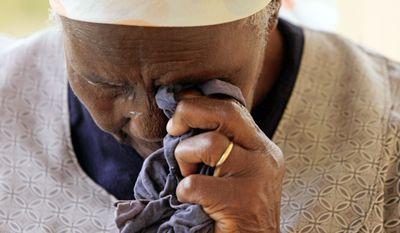 Martha Mahlangu cries as she talks about her late son, Solomon, an anti-apartheid guerrilla who was hanged on April 6, 1979. (Associated Press)