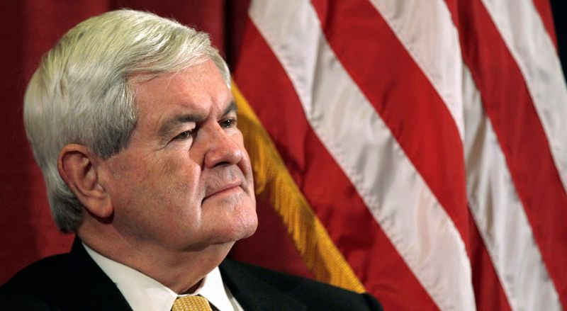 """Former House Speaker Newt Gingrich listens as he is introduced during a campaign stop in Manchester, N.H., on Wednesday. Mr. Gingrich traded jabs with Mr. Romney on the stump. He tied Mr. Romney to """"falsehoods"""" in campaign ads. Rep. Ron Paul of Texas,(right), a GOP presidential hopeful, speaks during a campaign stop in Fort Madison, Iowa, on Wednesday. The lawmaker has been linked to anti-Gingrich campaign ads in Iowa."""